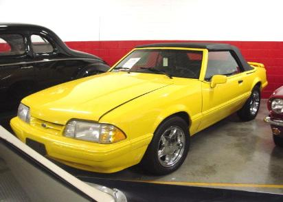 1993 Mustang LX Feature Car 5.0L V8 5 speed, Only 50 miles, Yellow-black top-black leather. A flawless and totally original represention bought new by Bob Killian.