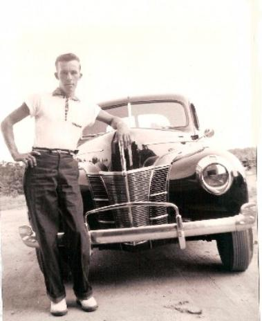 Bob Killian posing with one of his first 1940 Ford Coupes